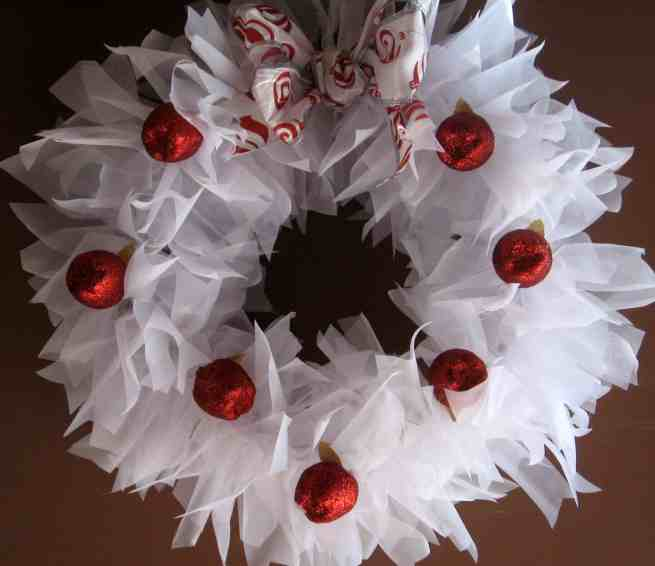 a round 12″ wreath red, white and green tulle. (I purchased a 50 yard spool of each and used only half of the red and green, but near all of the white). Christmas Ornaments and decor of your choice – I gathered mine from the Dollar Store, Walmart and Kmart. Hot glue gun & Hot glue. Begin simply.